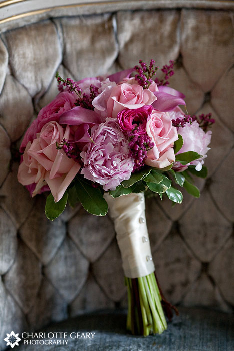 Pink bridal bouquet with roses, calla lilies, and peonies