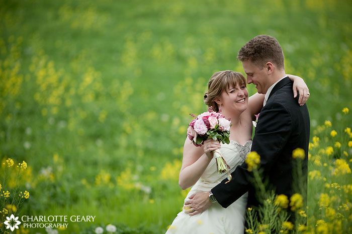 Bride and groom in a field of yellow flowers
