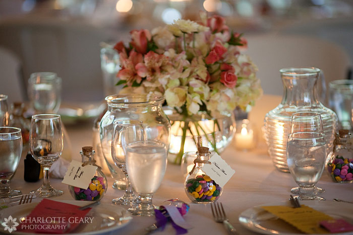 Table settings, centerpiece, and favors at a Hillside Gardens wedding