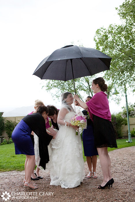 Bride and bridesmaids on rainy day