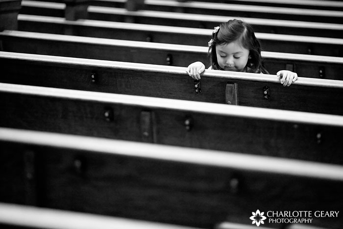 Flower girl in church pews