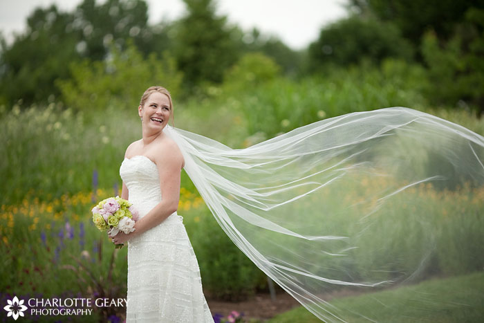 Bride with long veil at Hudson Gardens wedding