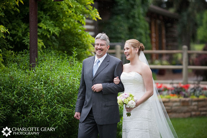 Bride and her father walking down the aisle in the rain at Hudson Gardens