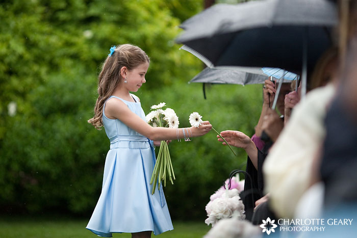 Flower girl with daisies and blue dress