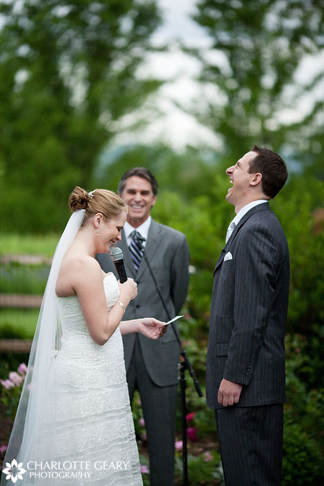Bride and groom laughing during ceremony at Hudson Gardens