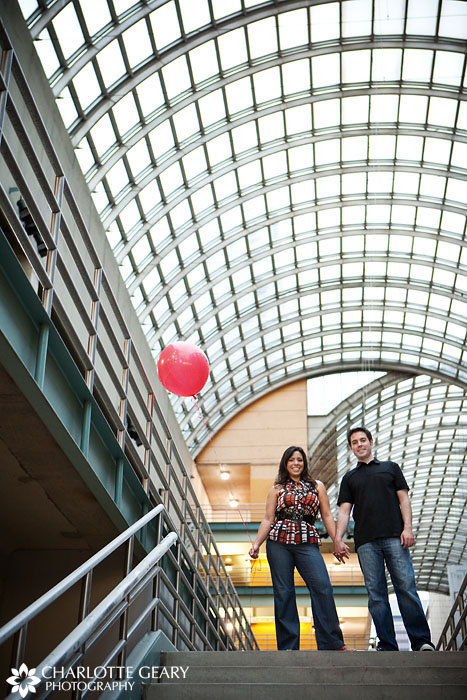 Engagement portrait with red balloon at the Denver Center for the Performing Arts