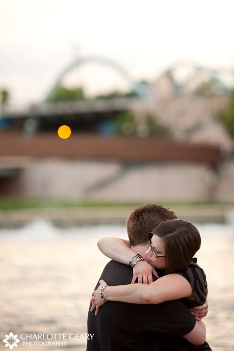 Engagement portrait by the river in downtown Denver