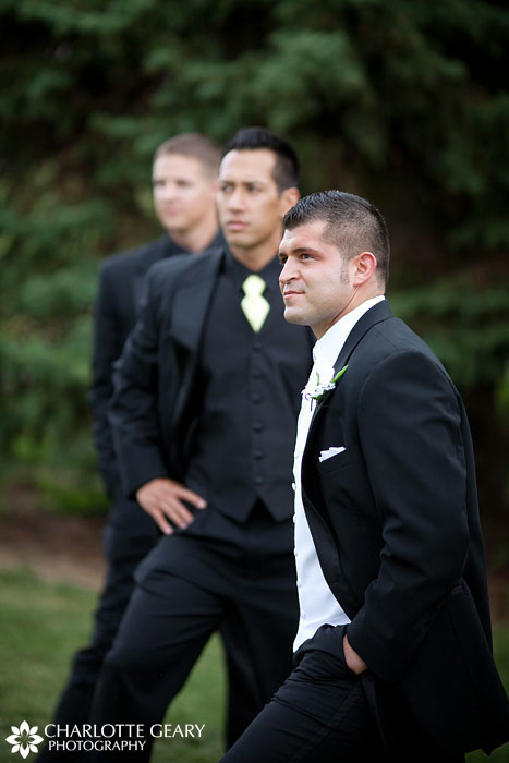 Groom with groomsmen in black suits and black shirts