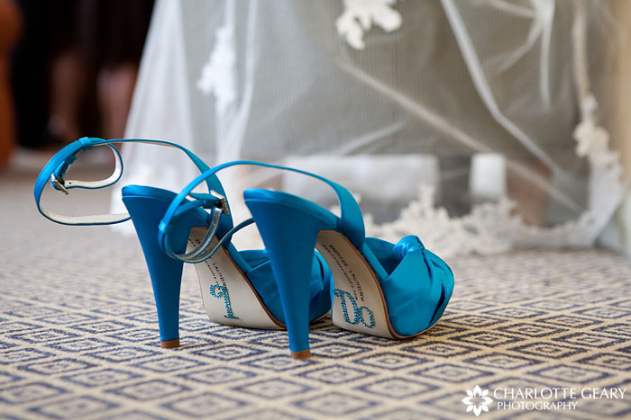 Blue bridal shoes with I Do on the soles