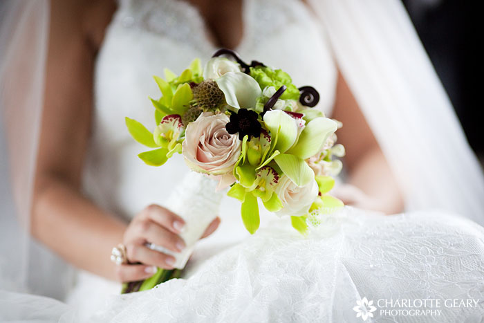 Green and brown bridal bouquet with orchids