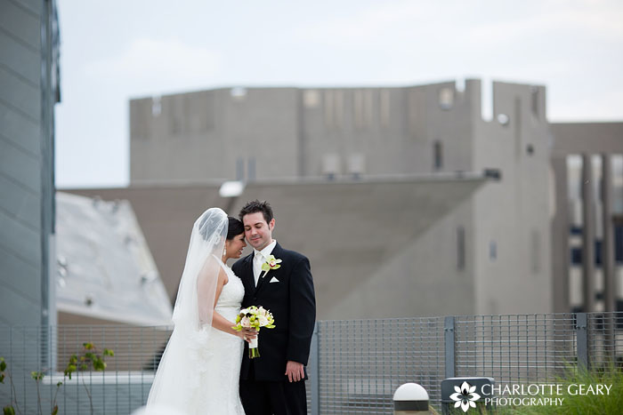 Bride and groom in front of the Denver Art Museum