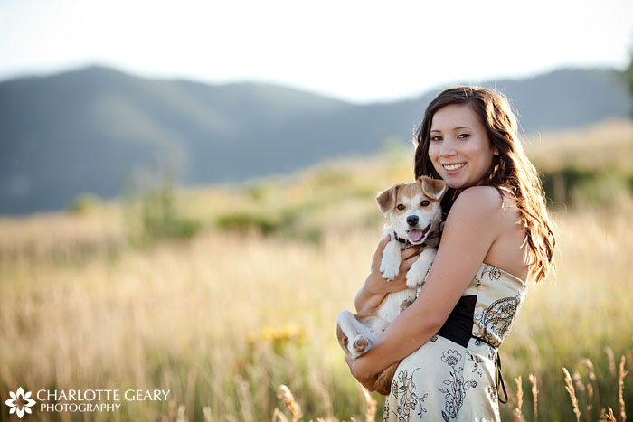 Senior portrait with a dog in the mountains