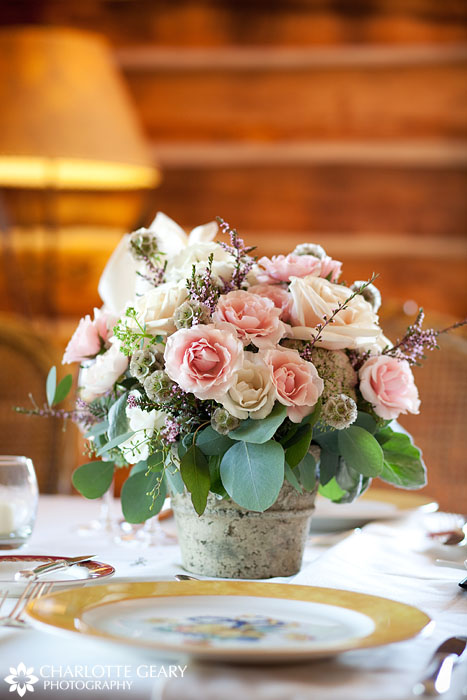 Wedding centerpiece with light pink and white roses