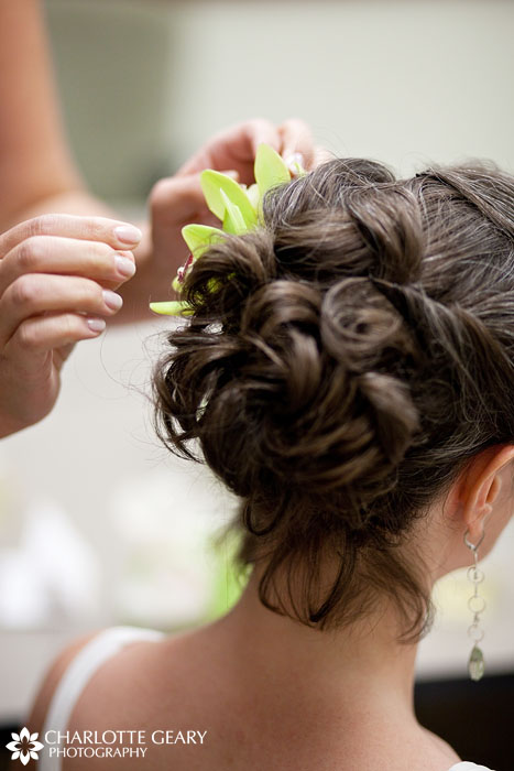 Green orchid in bride's hair