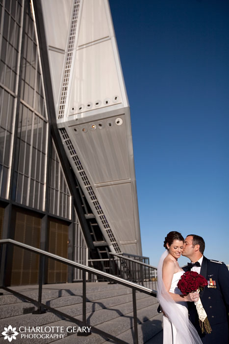 Bride and groom on the steps of the Air Force Academy Chapel